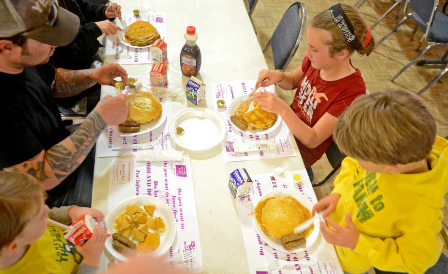 Children and adults eat pancakes and sausage at the 58th Annual Lions Club Pancake Jamboree last year at the Lions Club Building. James Durbin/Reporter-Telegram Photo: JAMES DURBIN