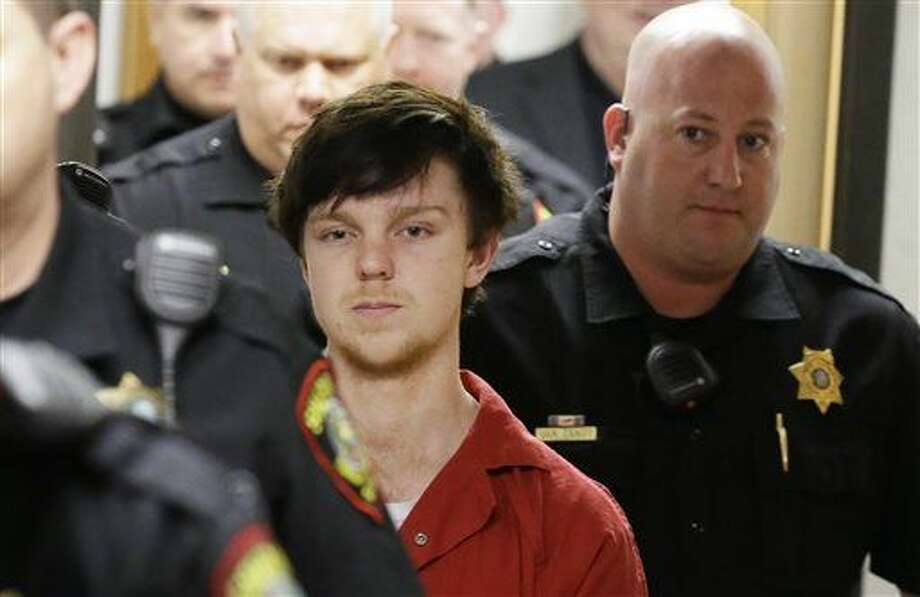 "Ethan Couch is led by sheriff deputies after a juvenile court for a hearing Friday, Feb. 19, 2016, in Fort Worth, Texas. A Texas judge ruled Couch, who used an ""affluenza"" defense in a fatal drunken-driving wreck will be moved to adult court, meaning the teen could face jail time for the 2013 wreck that killed four people. (AP Photo/LM Otero)"