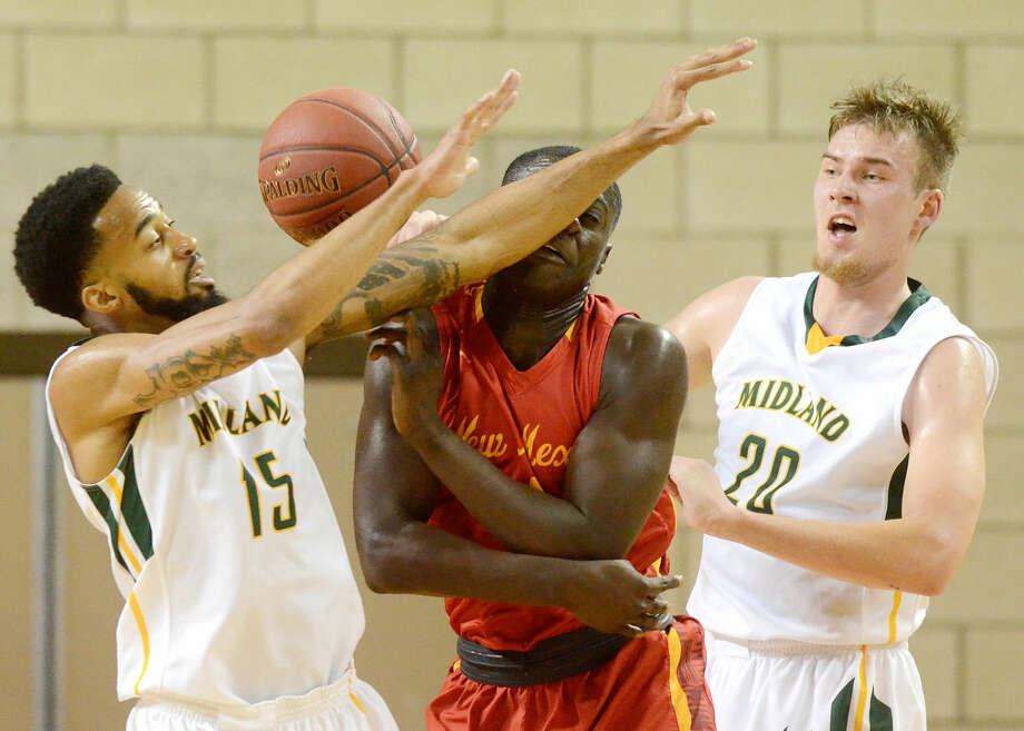 Midland College's Solomon Hainna (15) and Norbertas Giga (20) take the ball away while guarding New Mexico Junior College's Emmanuel Ansah (1) on Thursday, Feb. 18, 2016, at Chaparral Center. James Durbin/Reporter-Telegram Photo: James Durbin