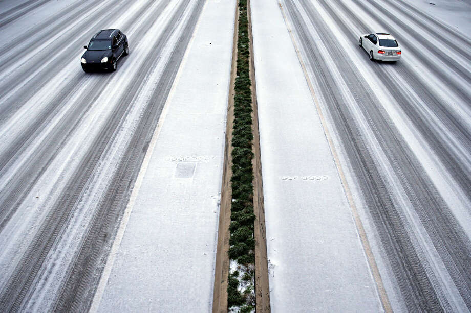 "Few cars travel along US 75 at Caruth Haven during heavy sleet Monday, Feb. 23, 2015 in Dallas. Freezing rain coated parts of Texas with ice on Monday, leading to hundreds of canceled flights and a delay in the ""American Sniper"" murder trial. (AP Photo/The Dallas Morning News, G.J. McCarthy) MANDATORY CREDIT; MAGS OUT; TV OUT; INTERNET USE BY AP MEMBERS ONLY; NO SALES Photo: G.J. McCarthy"