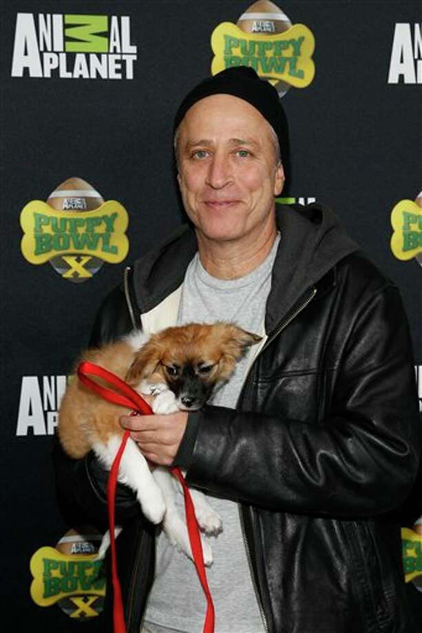 IMAGE DISTRIBUTED FOR DISCOVERY COMMUNICATIONS - TV Personality Jon Stewart attends the Puppy Bowl X at the Discovery Times Square Experience in New York on Tuesday, Jan. 28, 2014. (Mark Von Holden/AP Images for Discovery Communications) Photo: Mark Von Holden  / AP Images