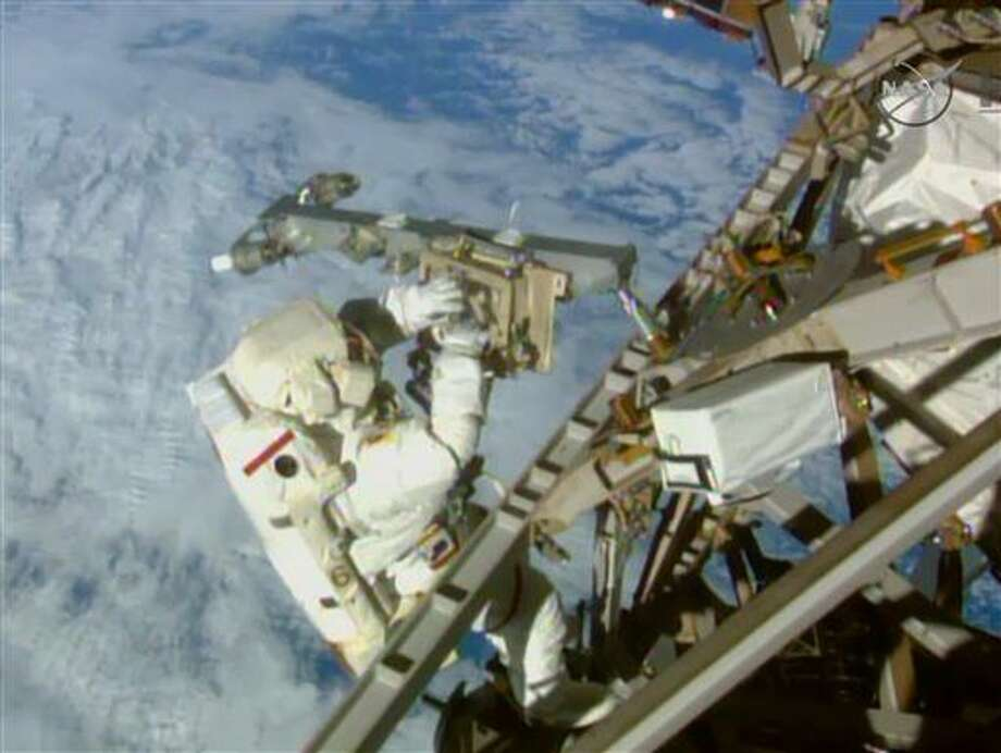 In this Sunday, March 1, 2015 image made from video provided by NASA, astronaut Terry Virts installs an antenna and boom during a spacewalk outside the International Space Station. On Friday, Feb. 19, 2016, NASA announced it received a record number of applicants _ some 18,300 _ for its next astronaut class. That's more than double the previous record of 8,000 for the first space shuttle astronaut class in 1978. (AP Photo/NASA-TV) Photo: HOGP