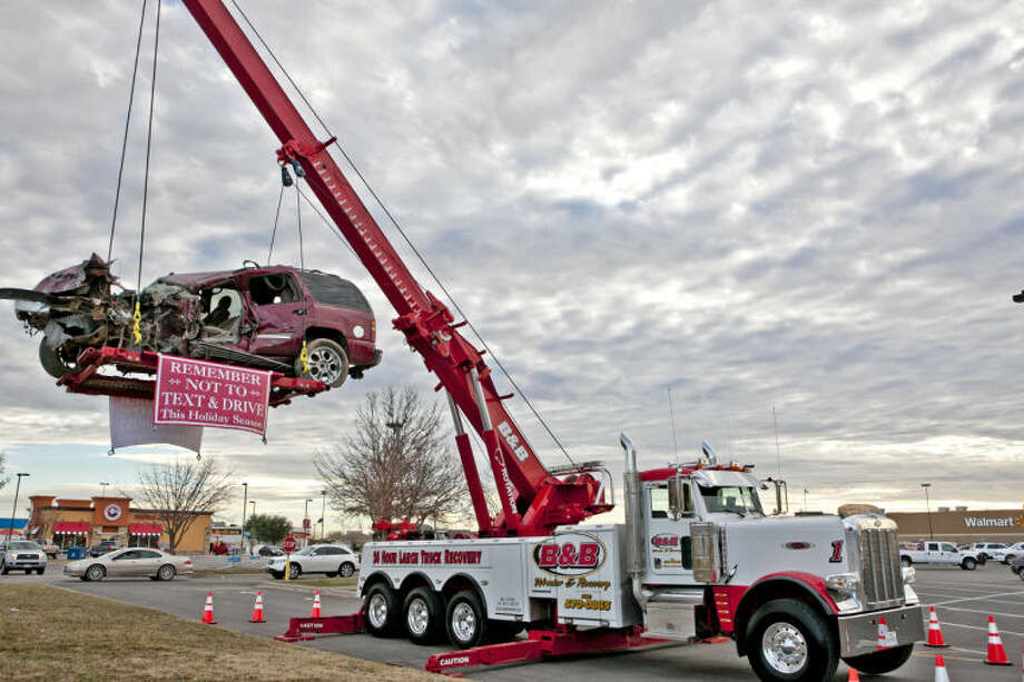 (File Photo) B&B Wrecker & Recovery put up a reminder to not text or drink and drive outside the north side Wal-Mart Nov. 30, 2014. James Durbin/Reporter-Telegram Photo: JAMES DURBIN
