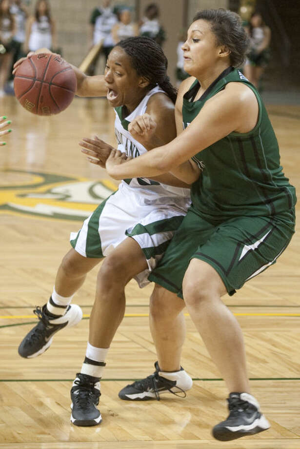 Midland College's Mary Savoy drives the lane as Clarendon's Delany Burney defends Monday evening at the Chaparral Center. Tim Fischer\Reporter-Telegram Photo: Tim Fischer