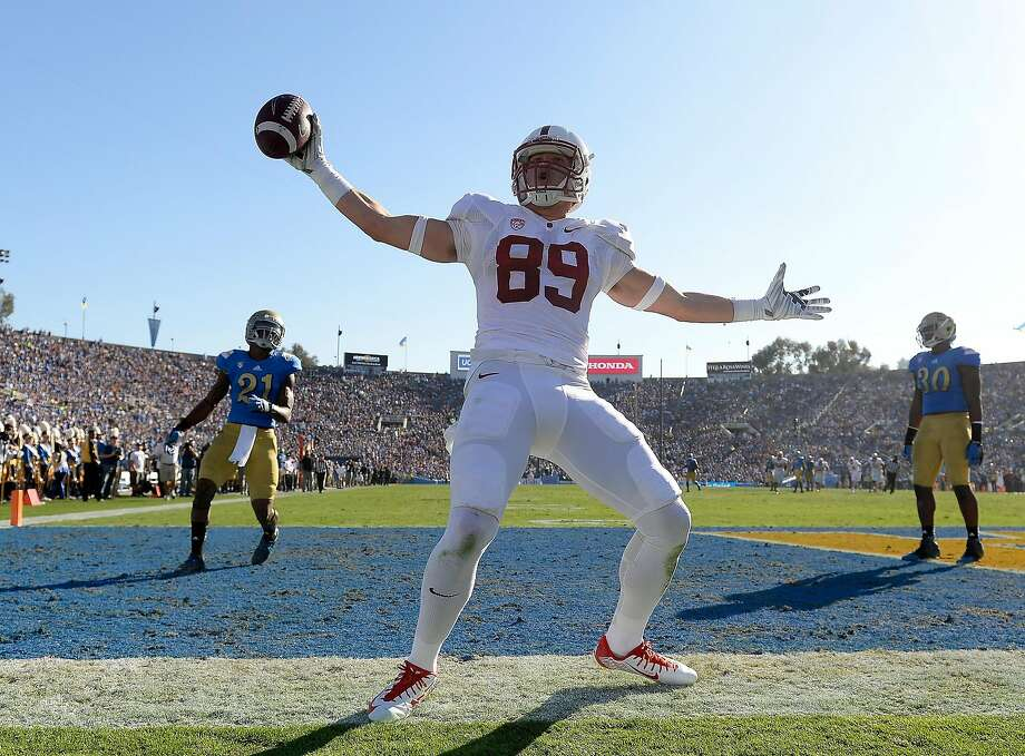 PASADENA, CA - NOVEMBER 28:  Devon Cajuste #89 of the Stanford Cardinal celebrates his touchdown for a 21-10 lead in front of Tahaan Goodman #21 and Myles Jack #30 of the UCLA Bruins during the second quarter at Rose Bowl on November 28, 2014 in Pasadena, California.  (Photo by Harry How/Getty Images) Photo: Harry How, Getty Images