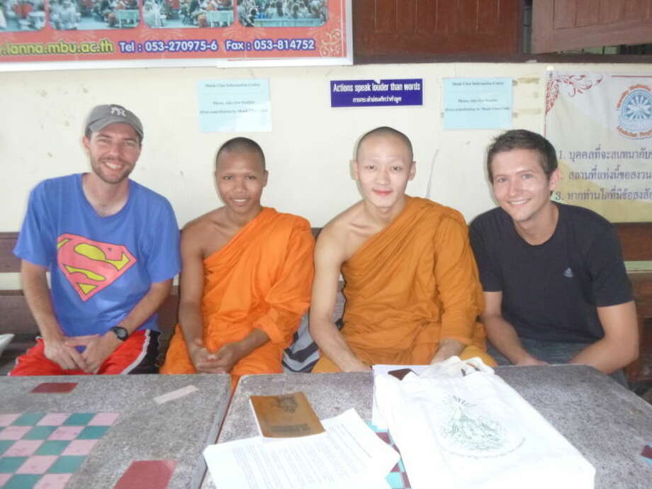 Joey Willis sits with Buddhist monks in Thailand. Photo: Courtesy Photo