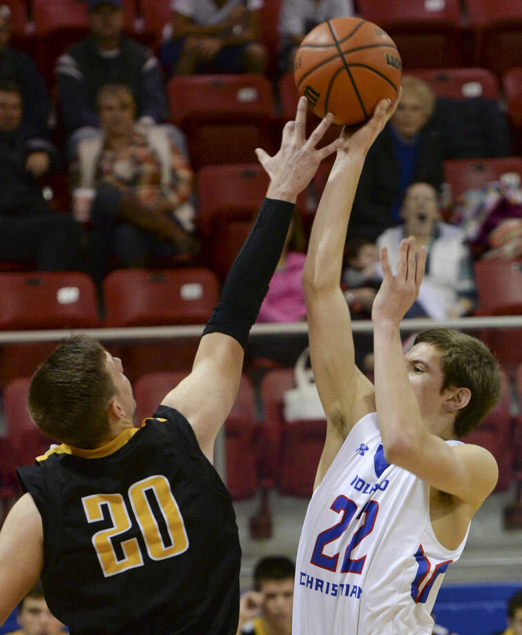 Midland Christian's Colton Snively puts up a shot as Seminole's Carter Laramore defends Tuesday 12-15-2015 at the McGraw Events Center. Tim Fischer\Reporter-Telegram Photo: Tim Fischer