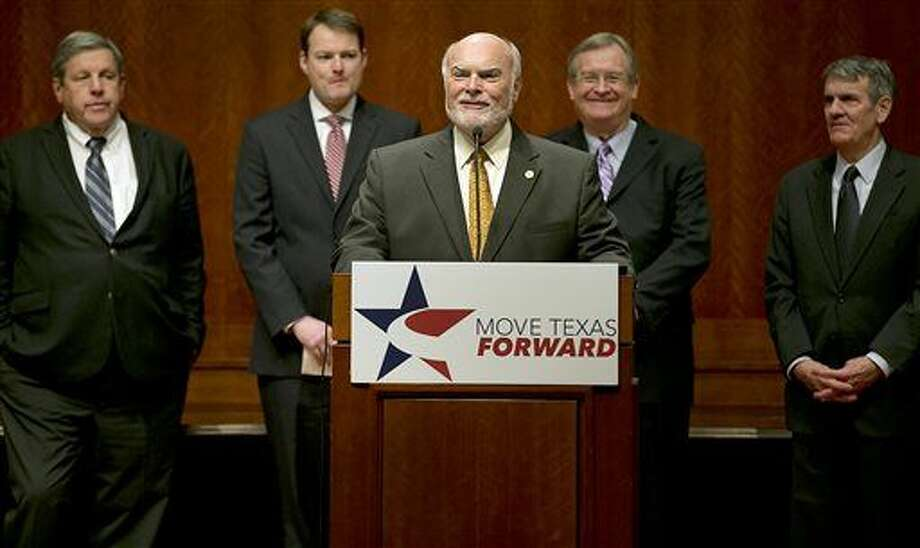 Texas Sen. Robert Nichols, center, host of SB5 and SJR5, talks about the need for increased funding for transportation during a news conference at the Capitol in Austin, Texas on Tuesday, Feb. 24, 2015. Move Texas Forward hosted the event to support SB5 and SJR5 which would constitutionally dedicate a portion of the state's existing Motor Vehicle Sales Tax to fund roads. (AP Photo/Austin American-Statesman, Ralph Barrera) AUSTIN CHRONICLE OUT, COMMUNITY IMPACT OUT, INTERNET AND TV MUST CREDIT PHOTOGRAPHER AND STATESMAN.COM, MAGS OUT Photo: Ralph Barrera