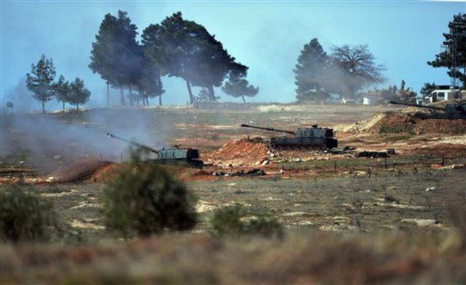"Turkish artillery fire from the border near Kilis town toward northern Syria, in Kilis, Turkey, Tuesday, Feb. 16, 2016. A Turkish official says his country is pushing the case for ground operations in Syria, hoping for the involvement of the U.S. and other allies in an international coalition against the Islamic State group. The official told reporters in Istanbul that ""without ground operations it is impossible to stop the fighting in Syria"" and that Turkey has pressed the issue in recent discussions with the U.S. and other Western nations. (AP Photo/Halit Onur Sandal) Photo: Halit Onur Sandal"