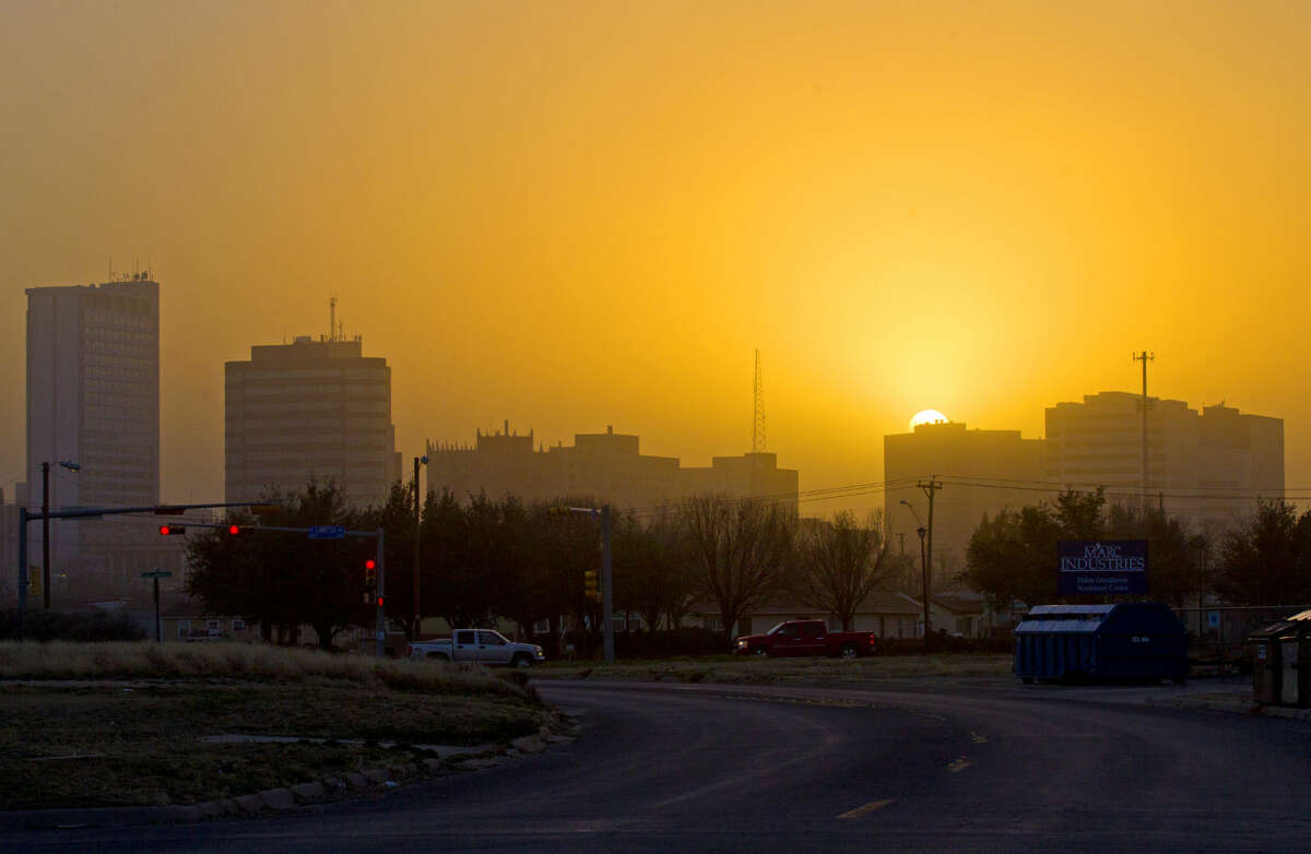 High winds kicked up a dust storm in Midland at sunset, Wednesday, Jan. 4, 2015. James Durbin/Reporter-Telegram