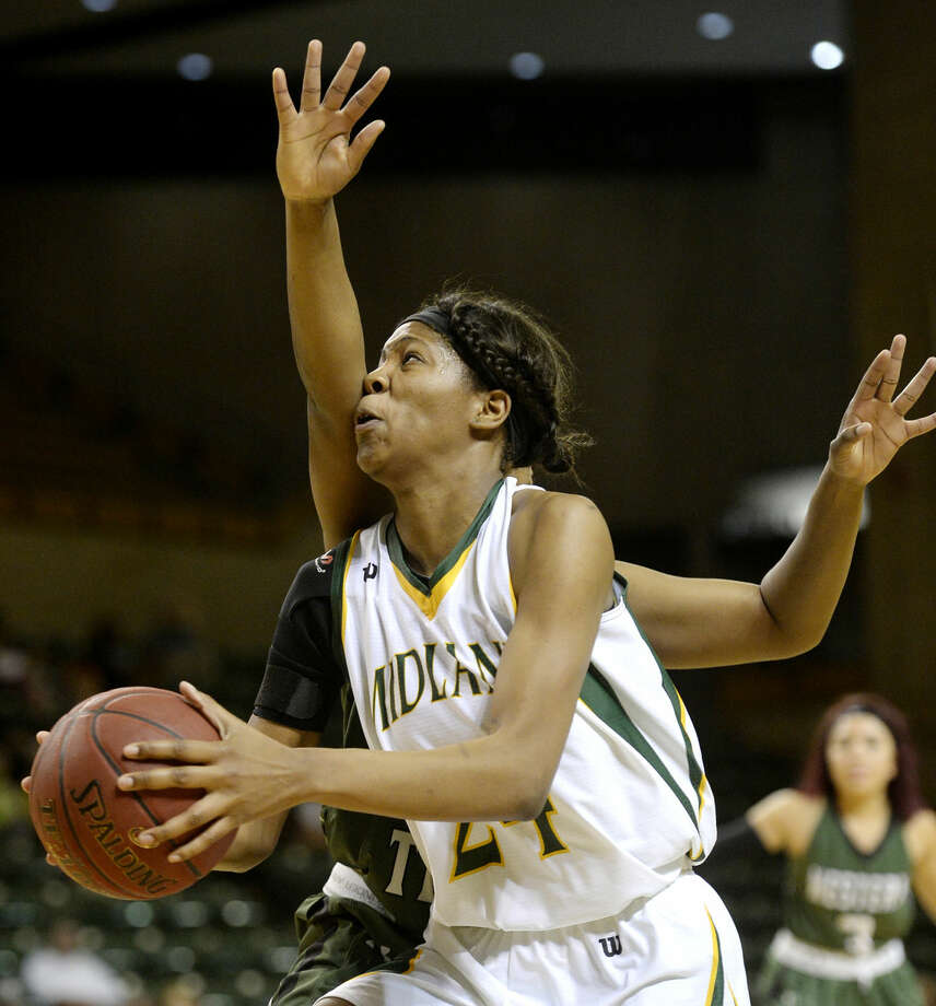 Midland College's Walnatia Wright (24) drives for the hoop while being guarded by Western Texas College's Brittany Thompson (21) on Thursday, Feb. 11, 2016, at Chaparral Center. James Durbin/Reporter-Telegram Photo: James Durbin