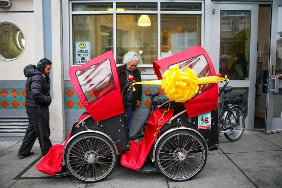 (l-r) Teresita Lahiff and Diane Evans take a look at tricycle rickshaws that were donated to the Curry Senior Center by Zendesk, in San Francisco, California, on Friday, May 6, 2016.