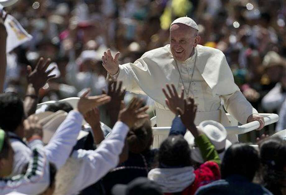 Pope Francis waves to the crowd as he leaves after celebrating Mass in San Cristobal de las Casas, Mexico, Monday, Feb. 15, 2016. Francis is celebrating Mexico's Indians on Monday with a visit to Chiapas state, a center of indigenous culture, where he will preside over a Mass in three native languages thanks to a new Vatican decree approving their use in liturgy. The visit is also aimed at boosting the faith in the least Catholic state in Mexico. (AP Photo/Eduardo Verdugo) Photo: Eduardo Verdugo