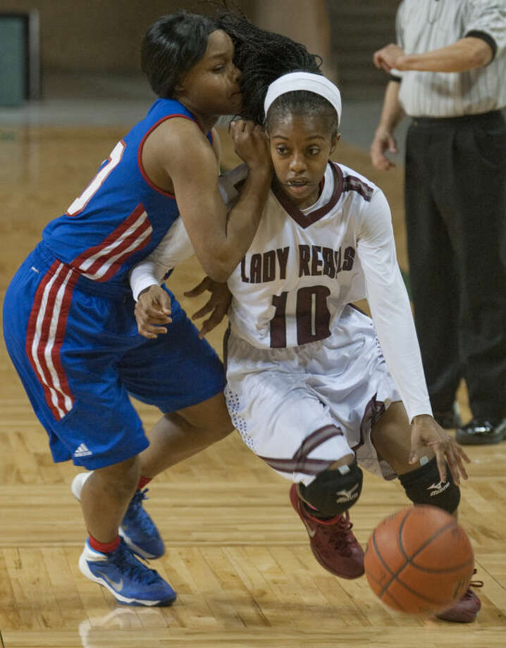 Abilene Cooper's Kennedy Barnes is called for a hold as Lee's Daija Stanford tries to get around her in this Feb. 4 file photo at Chaparral Center. Tim Fischer\Reporter-Telegram Photo: Tim Fischer