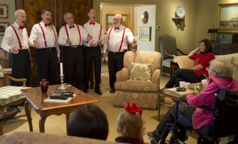 Members of 3 Nice Guys, Richard Rausch, baritone, Randy Burrell, lead, Lyn Fite, bass, Robert McGuire, bass and Ken Morrison, tenor, sing love songs to Judy Norwood Friday 02-12-16 for a Valentine's Day treat. Tim Fischer/Reporter-Telegram Photo: Tim Fischer