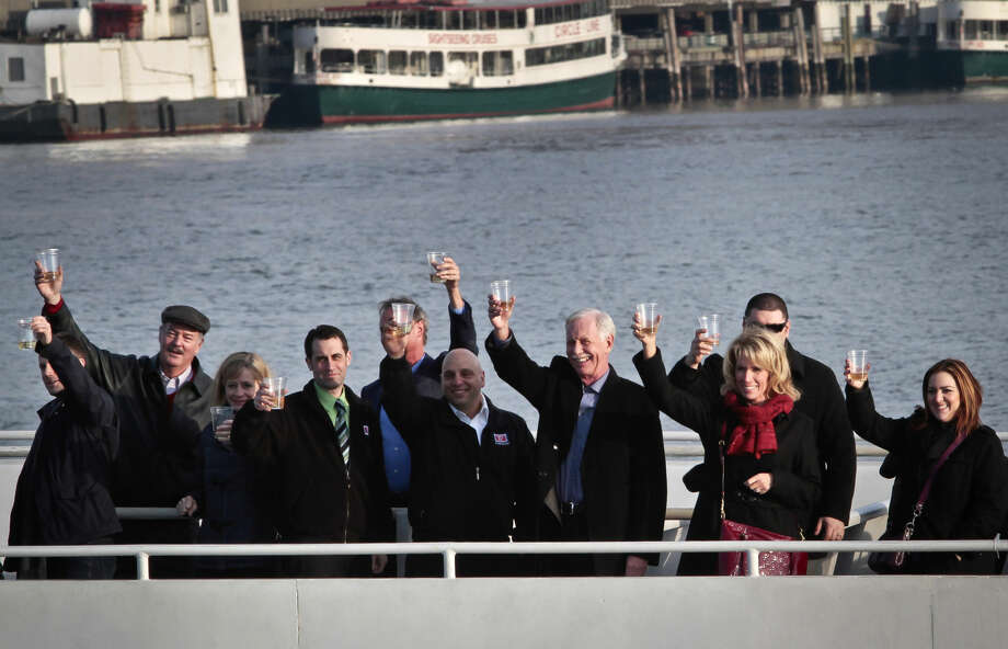 "Captain Chesley ""Sully"" Sullenberger III, fourth from right, pilot who safely glided U.S. Airways Flight 1549 with 155 passengers and crew to a water landing six years ago, join survivors and rescuers in a toast Jan. 15, 2014 marking the fifth anniversary of the event known as the ""miracle on the Hudson"" in New York. (AP Photo/Bebeto Matthews) Photo: Bebeto Matthews"