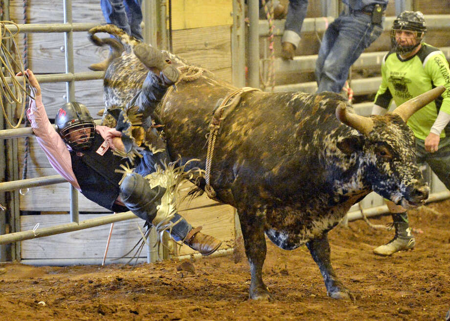 Jesse Hopper of Mangum, Okla., is thrown off while competing in the Best in the South Youth Bull Riding Championships on Saturday, Feb. 13, 2016, at Horseshoe Arena. James Durbin/Reporter-Telegram Photo: James Durbin