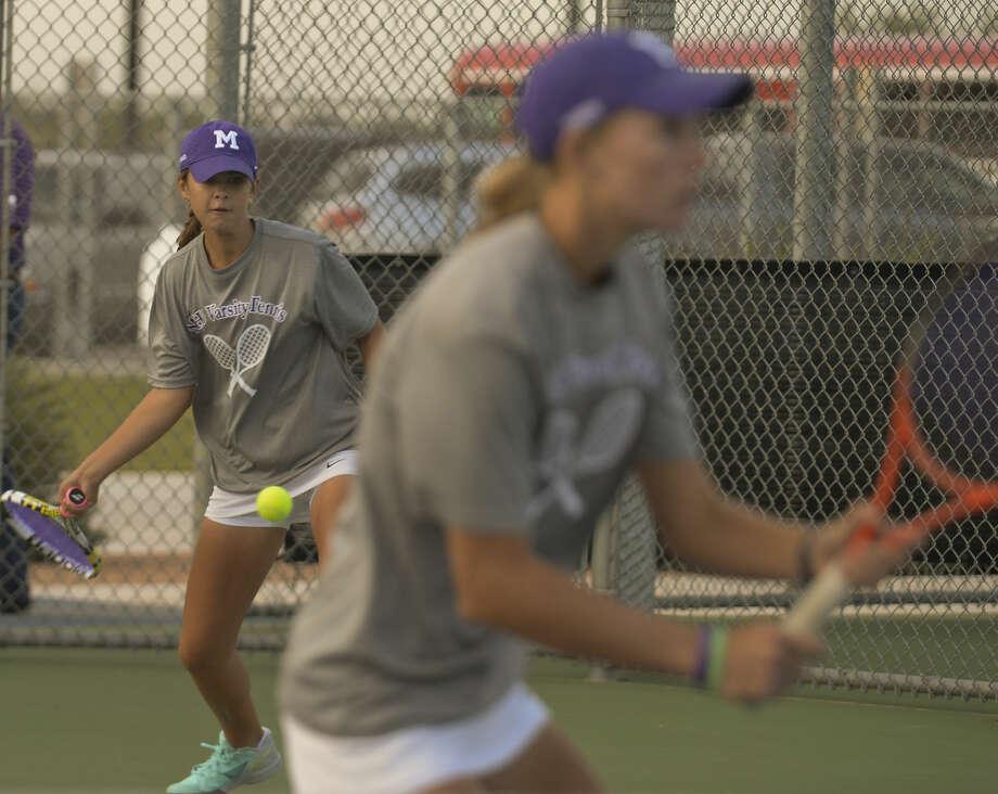 Allison Stewart returns a shot as doubles partner Kate Daugherty watches their opponents Tuesday 10-20-2015 at the District 3-6A/4-6A Tournament. Tim Fischer\Reporter-Telegram Photo: Tim Fischer