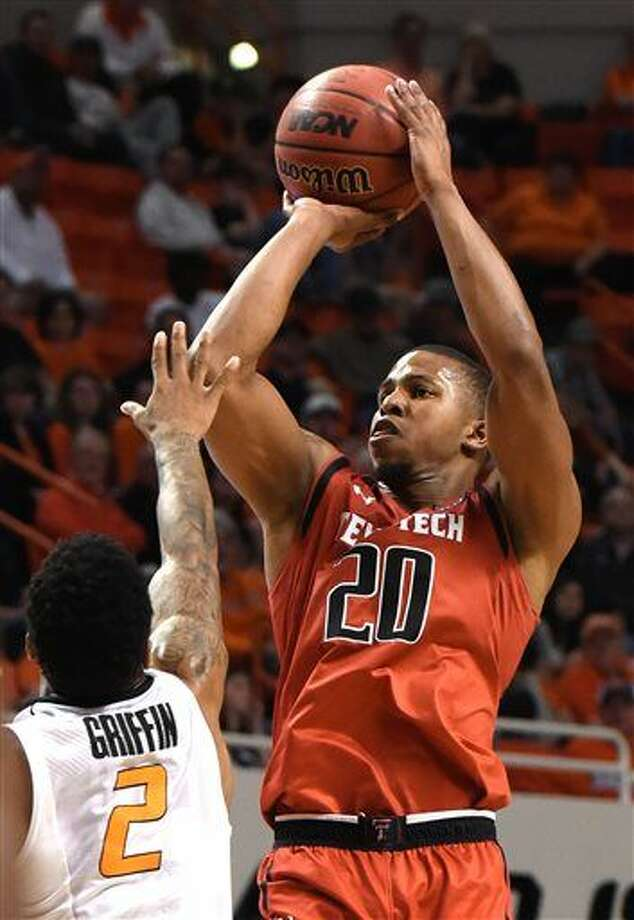 Texas Tech forward Toddrick Gotcher shoots over Oklahoma State guard Tyree Griffin during the second half of an NCAA college basketball game in Stillwater, Okla., Saturday, Feb. 20, 2016. Gotcher led Texas Tech scoring with 24 points in the team's 71-61 win. (AP Photo/Brody Schmidt) Photo: BRODY SCHMIDT