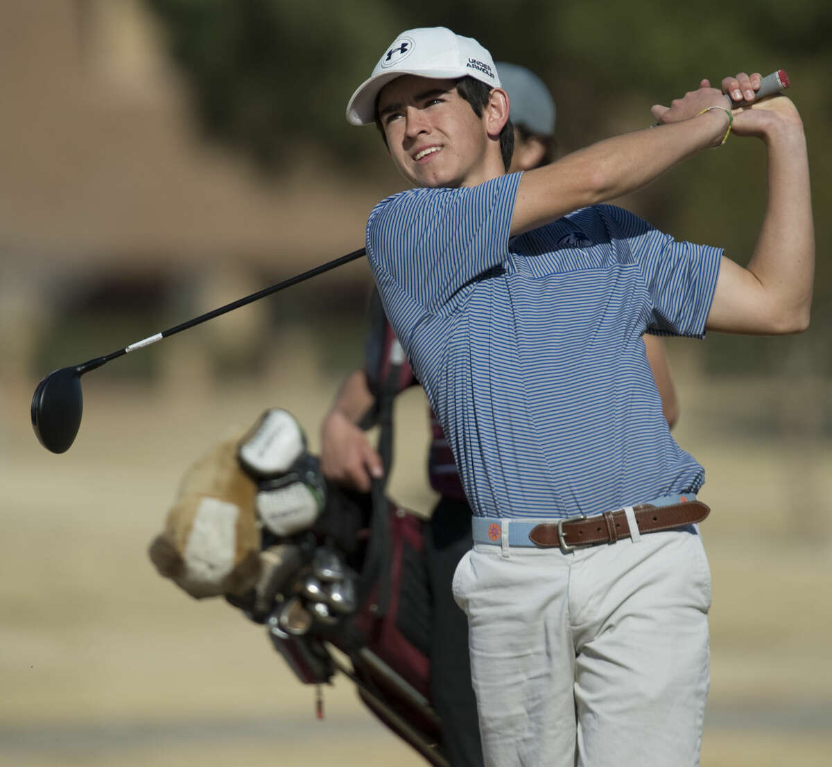 Trinity's Austin Escamilla follows his drive Friday 02-19-16 during the Bobby Dunn Golf Invitational at Greentree Country Club Tim Fischer/Reporter-Telegram