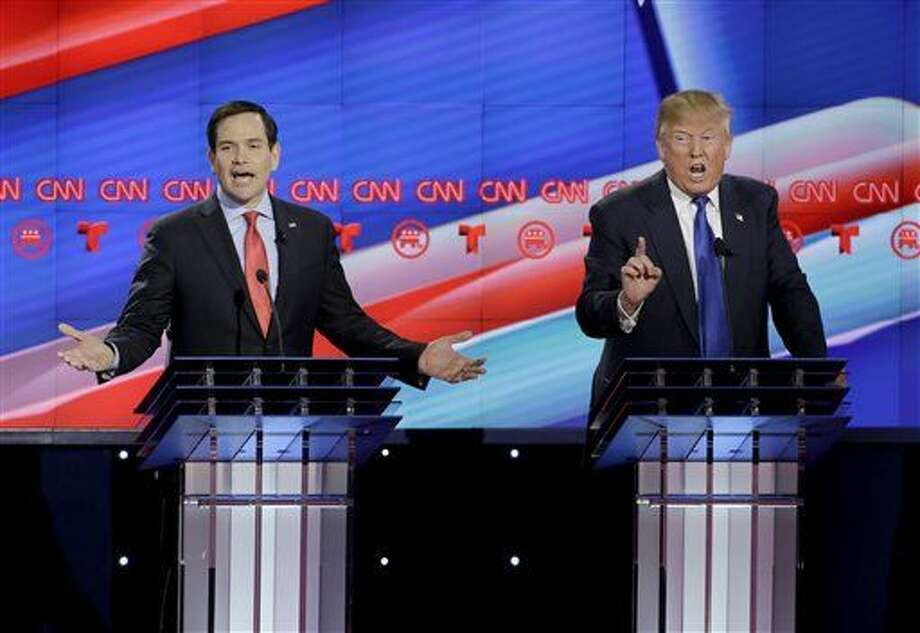 Republican presidential candidate, Sen. Marco Rubio, R-Fla., left, and Republican presidential candidate, businessman Donald Trump both speak during a Republican presidential primary debate at The University of Houston, Thursday, Feb. 25, 2016, in Houston. (AP Photo/David J. Phillip) Photo: David J. Phillip