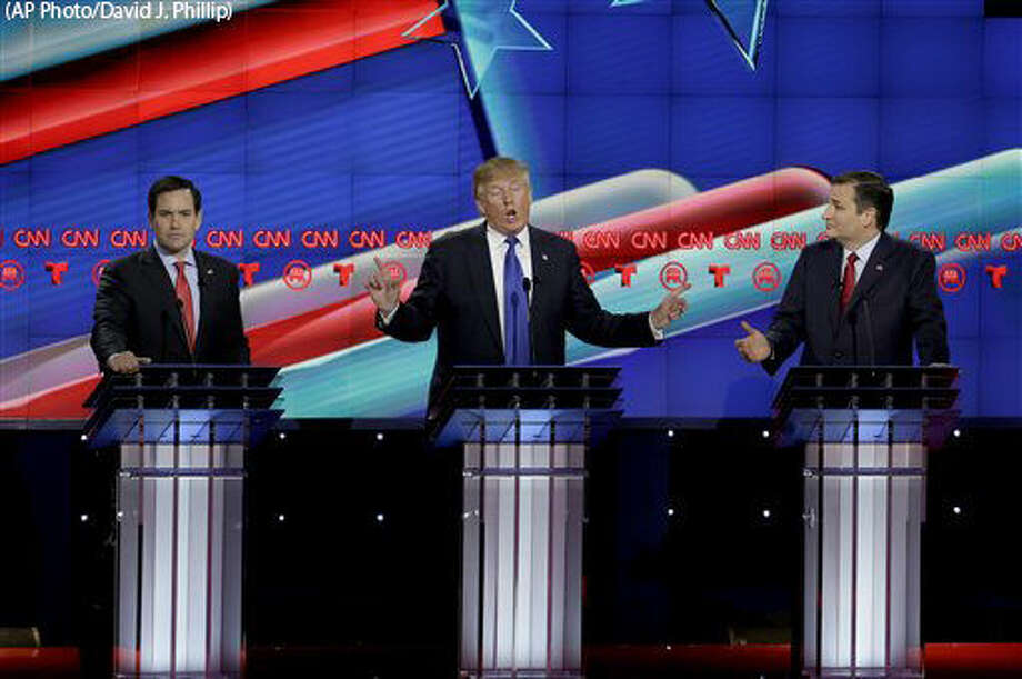 Republican presidential candidate, businessman Donald Trump, center, speaks as Republican presidential candidate, Sen. Marco Rubio, R-Fla., left, and Republican presidential candidate, Sen. Ted Cruz, R-Texas, right, react during a Republican presidential primary debate at The University of Houston, Thursday, Feb. 25, 2016, in Houston. (AP Photo/David J. Phillip) Photo: David J. Phillip