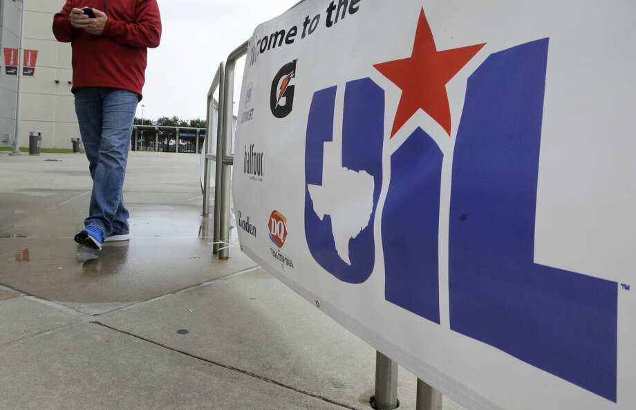 Clay Powell of Lubbock walks past one of the State UIL banners at NRG Park, Wednesday, Dec. 16, 2015, in Houston. The UIL Football State Championship games will be played December 17-19 at NRG Stadium. ( Melissa Phillip / Houston Chronicle ) Photo: Melissa Phillip
