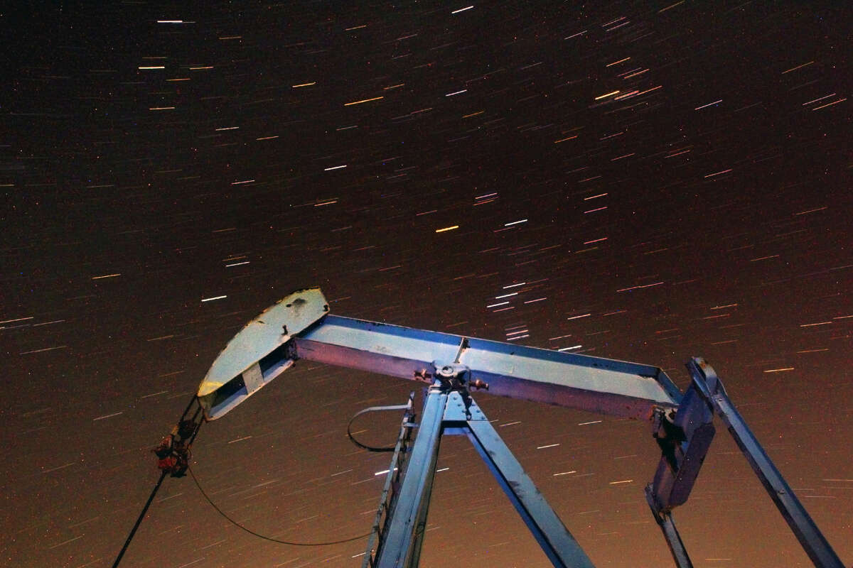 Stars move in the night sky behind an oil pumpjack located near Highway 349 and County Road 3200 in Martin County during a 10 minute long-exposure photograph taken Wednesday, Feb. 24, 2016. James Durbin/Reporter-Telegram