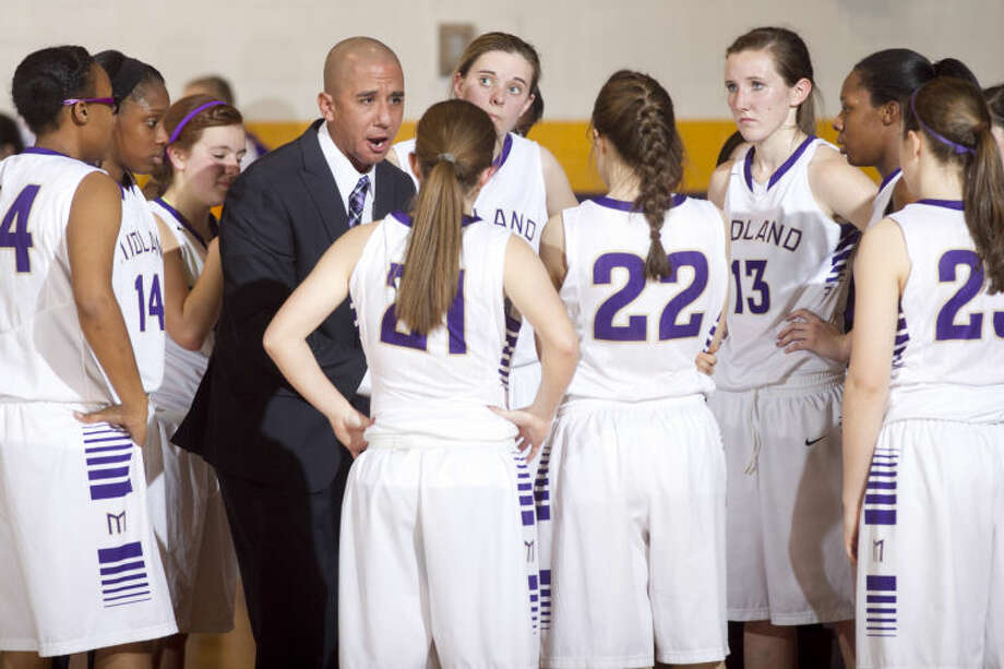 Midland High girls basketball head coach Wes Torres talks to his team during a time-out in the game against Abilene High on Tuesday at Midland High. James Durbin/Reporter-Telegram Photo: JAMES DURBIN