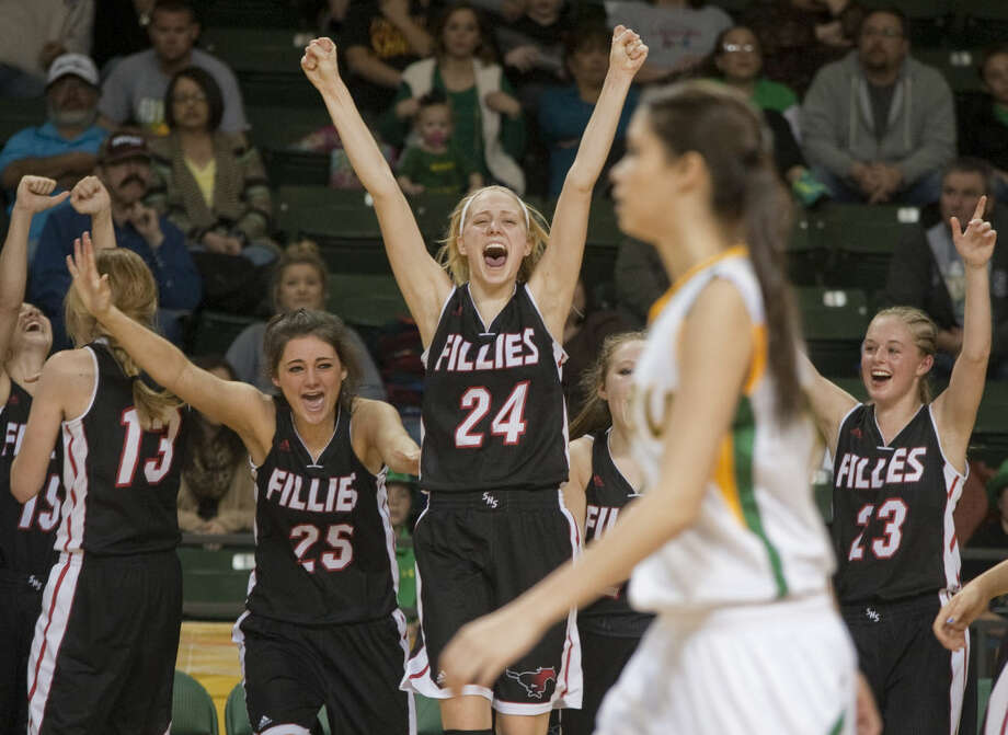 Shallowater players celebrate their 48-26 victory Sunday, 3-1-15, in the Region 1-3A girls final at Chaparral Center against Idalou. The Fillies will next play in the state tournament in San Antonio. Tim Fischer\Reporter-Telegram Photo: Tim Fischer