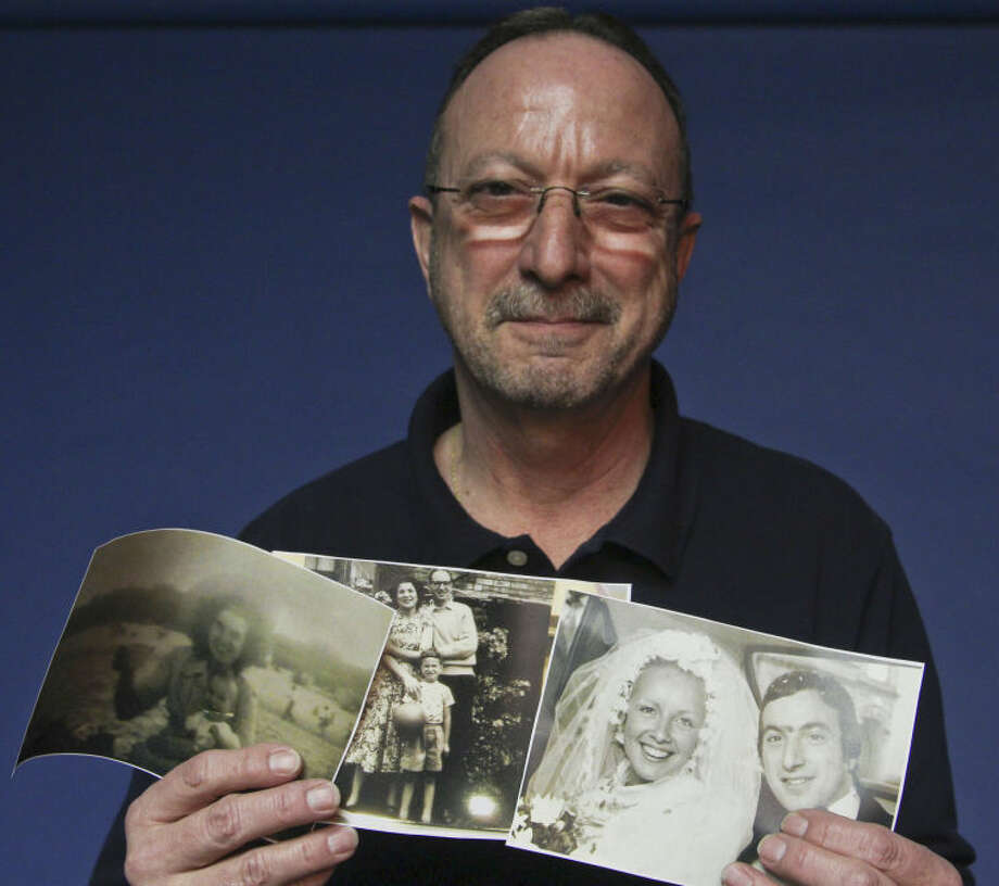 Vince Cone, the Reporter-Telegram's circulation director, holds up photographs taken as a young man living in England. Tyler White/Reporter-Telegram Photo: Tyler White