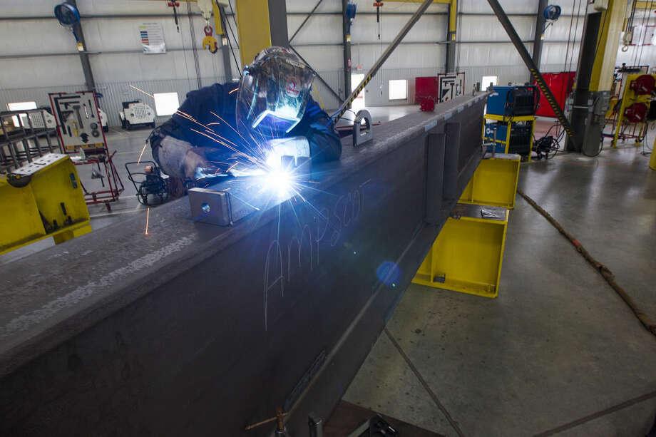 Jaime Olvera welds on a walking beam at the Weatherford rod-pump manufacturing plant Thursday, June 26, 2014, in Katy. ( Brett Coomer / Houston Chronicle ) Photo: Brett Coomer