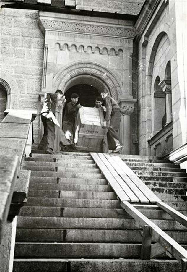 """This 1945 handout photo provided by the Smithsonian Institution shows the evacuating of artwork from Neuschwanstein Castle in Bavaria. Photographs, maps and records from the real corps of soldiers known as """"Monuments Men"""" who were tasked with protecting European cultural sites and recovering looted art during World War II are going on display in Washington, many for the first time. (AP Photo/Smithsonian Institution) Photo: Uncredited / Smithsonian Institution"""