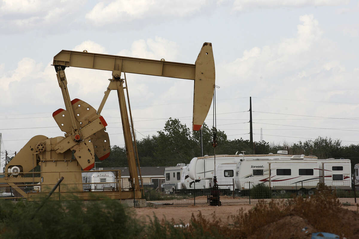 An RV park is located near a pump jack in Midland, Texas, Wednesday, July 25, 2012.