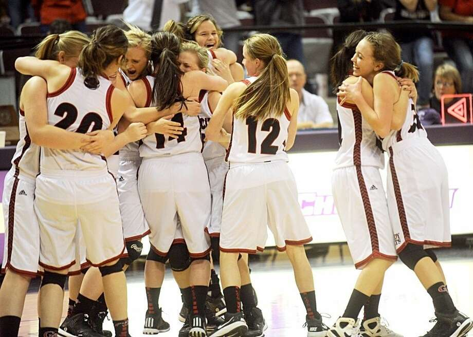 Garden City players celebrate their 49-42 victory over O'Donnell in the Region II-1A girls basketball championship game Sunday at Abilene Christian's Moody Coliseum. Joey D. Richards/Special to the Reporter-Telegram