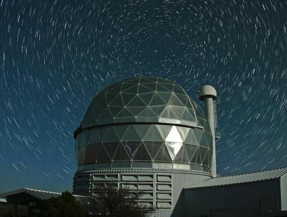The Hobby-Eberly Telescope is surrounded by star trails centered on Polaris, the North Star. Credit: Frank Cianciolo/McDonald Observatory. Photo: Frank Cianciolo