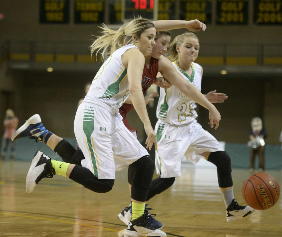 Idalou's Bailey Conklin (33) and Carli Fulcher (23) chase a loose ball against Jim Ned's Ryan Bush (5) in the UIL Region I-3A girls basketball semi-final on Friday, Feb. 26, 2016, at Chaparral Center. James Durbin/Reporter-Telegram Photo: James Durbin