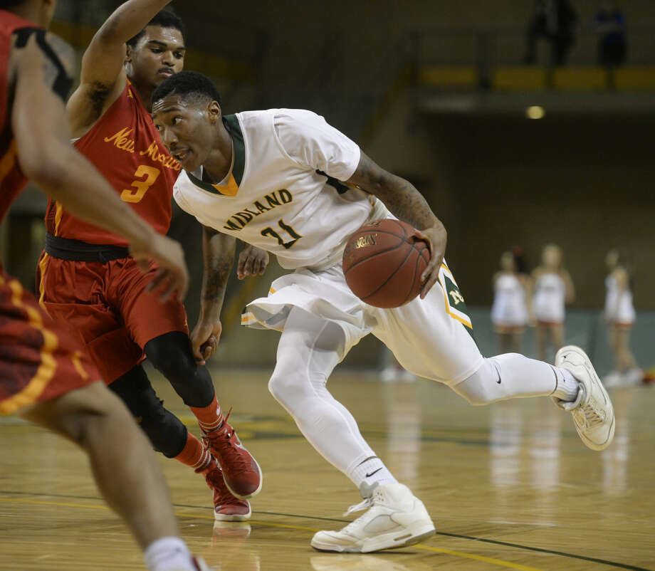 Midland College's Travaun Coad (21) moves the ball against New Mexico Junior College's Tyler Blount (3) on Thursday, Feb. 18, 2016, at Chaparral Center. James Durbin/Reporter-Telegram Photo: James Durbin