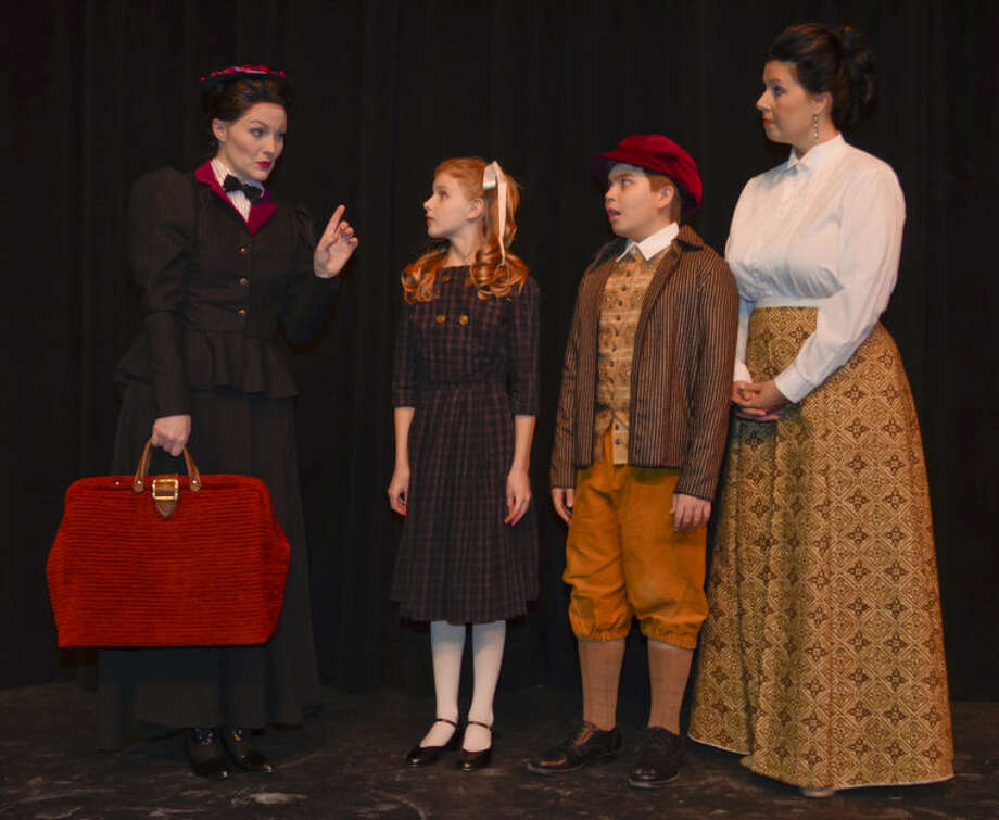 MAry Poppins, played by Kristen Loyd, talks with the Banks' family, Jane, Faith Berry, Michael, Sean Nail and Winifred Banks, Nikki Windham in MCT's production of Mary Poppins. Tim Fischer\Reporter-Telegram Photo: Tim Fischer
