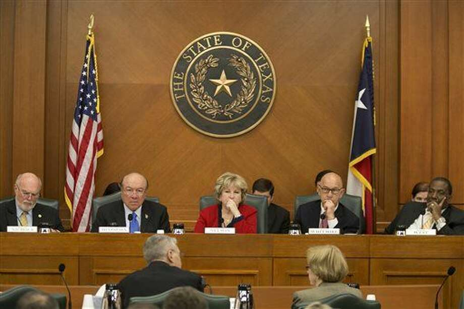 Members of the Senate Finance Committee listen to testimony from Texas Department of Public Safety Director Steven McCraw, bottom left, during a Senate Finance Committee hearing at the state Capitol in Austin, Texas, Monday, Feb. 23, 2015. Calls for an unprecedented Texas border security spending spree to buy spy planes, 500 more state troopers and a 10-acre training base near Mexico came under heavy bipartisan scrutiny Monday in a show of frustration with a priority of Republican Texas Gov. Greg Abbott. (AP Photo/Austin American-Statesman, Dborah Cannon) AUSTIN CHRONICLE OUT, COMMUNITY IMPACT OUT, INTERNET AND TV MUST CREDIT PHOTOGRAPHER AND STATESMAN.COM, MAGS OUT Photo: Dborah Cannon