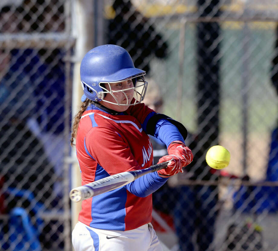 Midland Christian's Courtney Monk hits during a West Texas Classic matchup against Big Spring on Friday, Feb. 26, 2016, at Freddie Ezell Softball Complex. James Durbin/Reporter-Telegram Photo: James Durbin