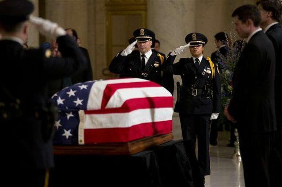Honor guards salute the flag-draped casket containing the body of the late Justice Antonin Scalia in the Great Hall of the Supreme Court in Washington, Friday, Feb. 19, 2016, where Scalia's body lies in repose. (AP Photo/Manuel Balce Ceneta) Photo: Manuel Balce Ceneta