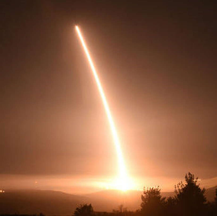 This Thursday, Feb. 25, 2016 photo provided by the U.S. Air Force shows an unarmed Minuteman 3 intercontinental ballistic missile launches during an operational test from Vandenberg Air Force Base, Calif. The unarmed missile roared out of its underground bunker on the California coastline and soared over the Pacific, inscribing the signature of American power amid growing worry about North Korea's pursuit of nuclear weapons capable of reaching U.S. soil.(Staff Sgt. Jim Araos/U.S. Air Force via AP) Photo: Jim Araos