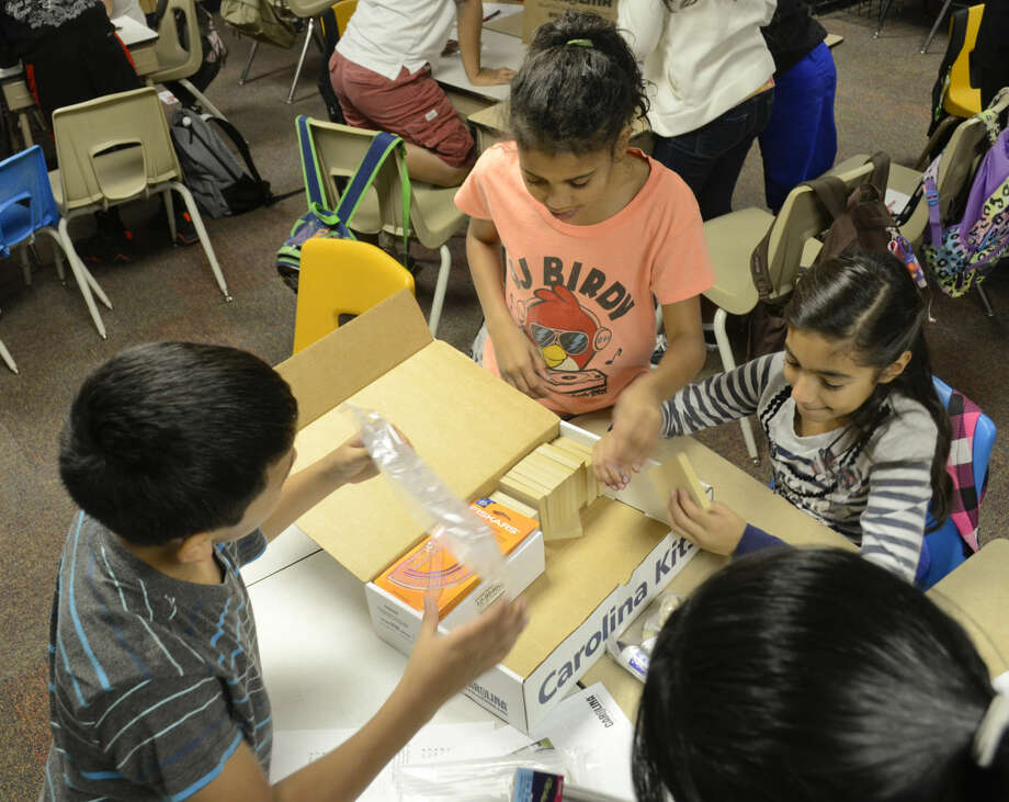 Fifth graders at Lamar Elementary look through new supplies they received Friday as part of a Fuel Your School grant program through Kent Kwik and Chevron. Tim Fischer\Reporter-Telegram Photo: Tim Fischer