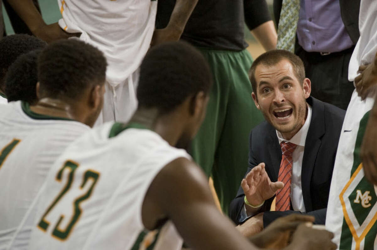 Midland College mens basketball coach Jordan Dreiling talks with his players during a timeout against Frank Phillips College Feb. 5 at Chaparral Center. Tim Fischer\Reporter-Telegram