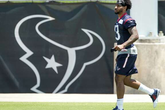 Houston Texans wide receiver Braxton Miller runs onto the practice field during rookie mini camp at The Methodist Training Center on Friday, May 6, 2016, in Houston.