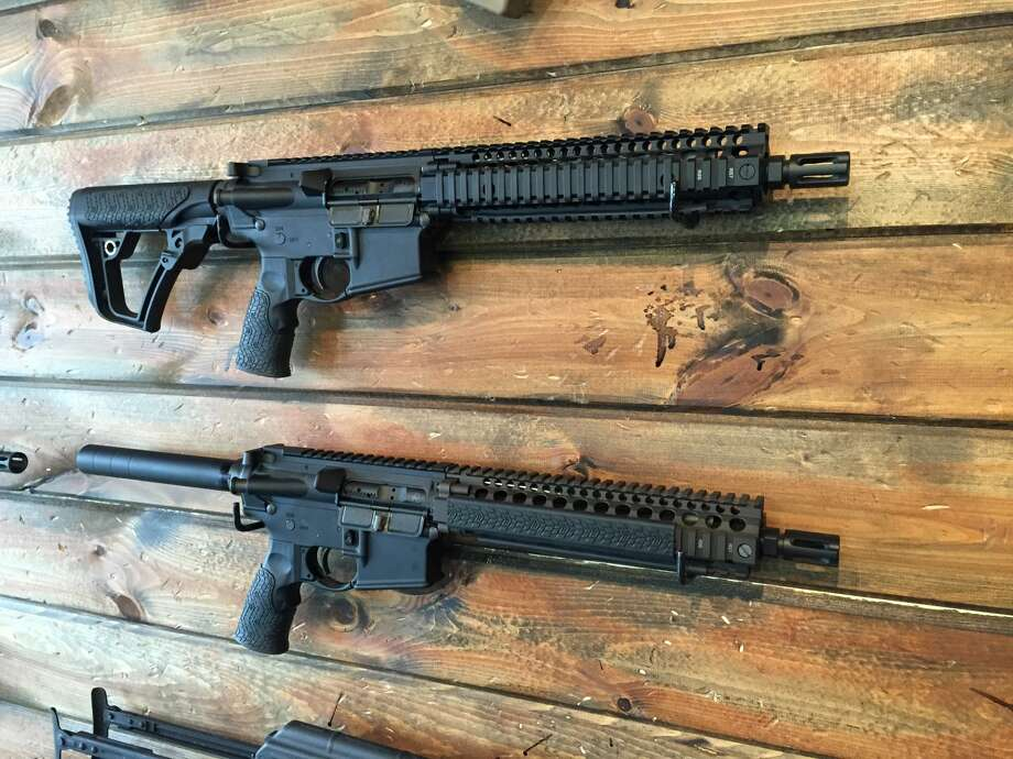 Slight differences: an AR-15 short barrel rifle above an AR-15 pistol.