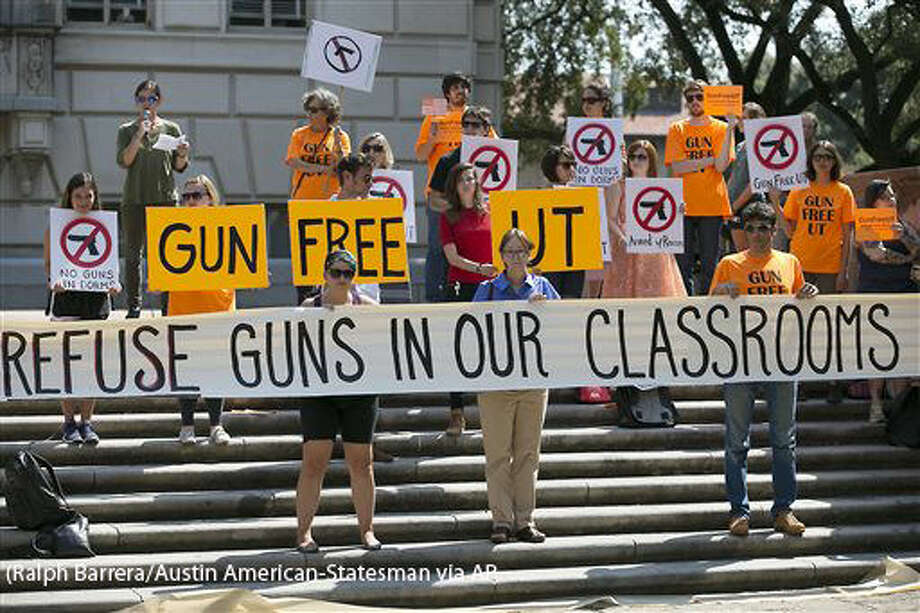 FILE - In this Oct. 1, 2015, file photo, protesters gather on the West Mall of the University of Texas campus to oppose a new state law that expands the rights of concealed handgun license holders to carry their weapons on public college campuses. University of Texas President Greg Fenves has approved rules that will allow concealed handgun license holders to bring their weapons into classrooms. State law requires public universities to allow concealed handguns in classrooms and buildings starting Aug. 1, 2016, but also gives campuses some leeway to carve out gun-free zones. (Ralph Barrera/Austin American-Statesman via AP, File) AUSTIN CHRONICLE OUT, COMMUNITY IMPACT OUT, INTERNET AND TV MUST CREDIT PHOTOGRAPHER AND STATESMAN.COM, MAGS OUT; MANDATORY CREDIT