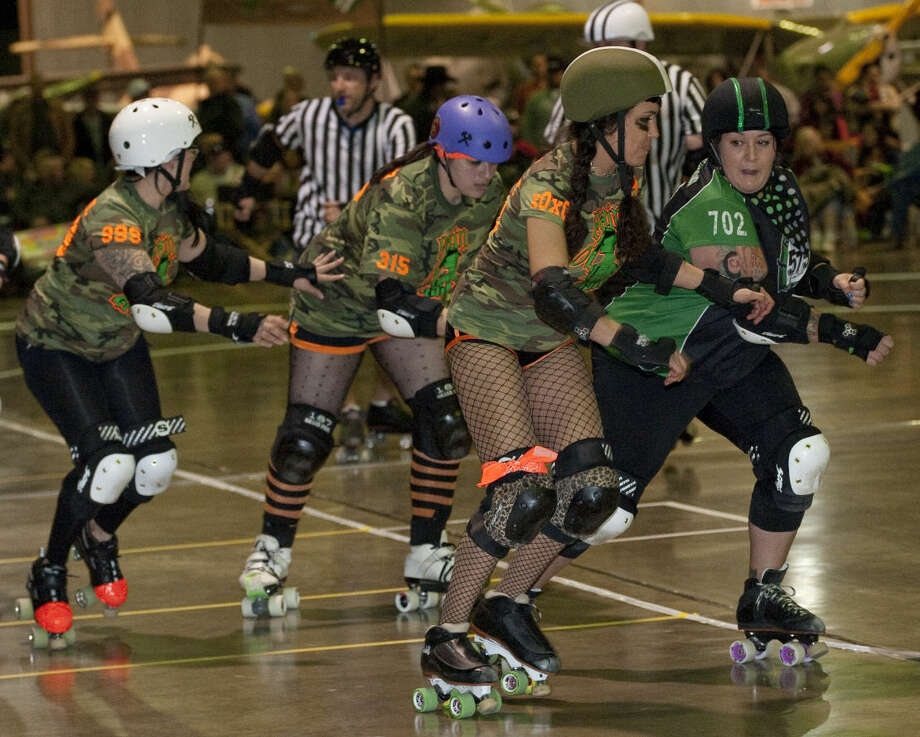 Members of the Pain Grenades, from Odessa/Midland in camo take on the 575 Roller Babes from Hobbs/Carlsbad in the season opener of The Tall City Roller Betties at the CAF Hanger in this file photo. Tim Fischer\Reporter-Telegram Photo: Tim Fischer
