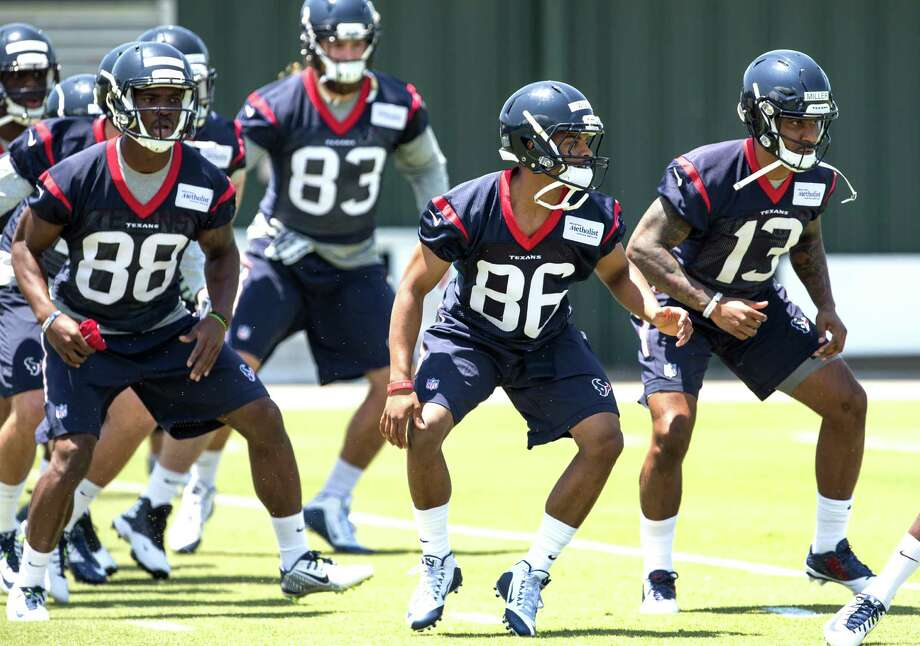 Houston Texans wide receivers Tevin Jones (88), Carlos Wiggins (86) and Braxton Miller (13) warm up during rookie mini camp at The Methodist Training Center on Friday, May 6, 2016, in Houston. Photo: Brett Coomer, Houston Chronicle / © 2016 Houston Chronicle